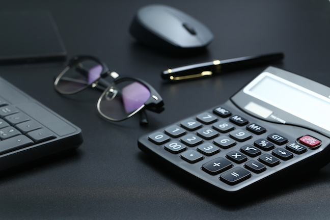 Calculator, eyeglasses, mouse