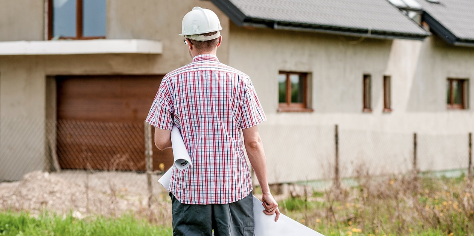 Advice for home builders from industry pros_builder walking with plans in hand