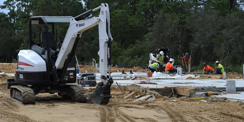 Construction workers work on concrete pad-new home construction-photo-hurlburt.af.mil
