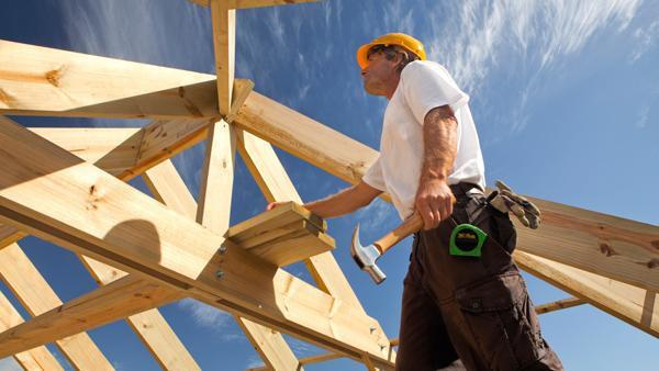 Construction worker framing house