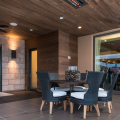 Used on the outdoor patio ceiling and a portion of the walls is 1- by 4-inch, tongue-and-groove Thermory Ash siding, sourced from sustainable forests and modified thermally to eliminate sugars and moisture that attract mold, reduce absorbency and increase stability.