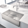 Made in Germany, Blanco's Precision apron-front sink features a rear-positioned drain hole for maximum usable bowl and a Durinox finish that is twice as hard as conventional stainless steel surfaces. It is paired with the Panera single-lever, pull-out faucet, made with stainless steel inside and out.