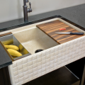 Easy access, big-basin farmhouse sinks are in demand. Stone Forest kicks up the beauty component in its Basket-Weave pattern sink from its Workstation Sink Collection. Carved from Papiro Cream marble, colander, cutting board and drying rack accessories are included.