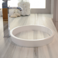 Created in partnership with kitchen and bath designer Matthew Quinn, the innovative Continuum round, oval or square style sink from MTI Baths' Boutique Collection uses the countertop cut-out to form the sink bottom, allowing counter material striations to visually flow 'through' the sink.