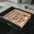 Spice drawer with dividers, photo courtesy KraftMaid