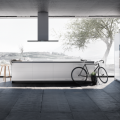 Modern kitchen open to outdoors, bicycle parked, photo courtesy SieMatic