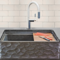 Easy access, big-basin farmhouse sinks are in demand. From Stone Forest's Workstation Sink Collection, the Wave Front is carved from honed basalt and outfitted with included colander, cutting board and drying rack.