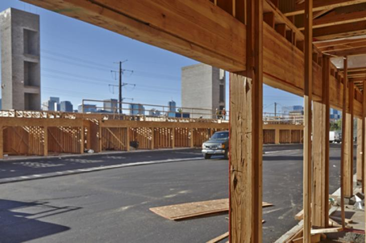 At Westend in Denver, an urban garden-style apartment complex, builders used glulam beams as headers over windows, doors, and garage doors, which saved money over alternative options.