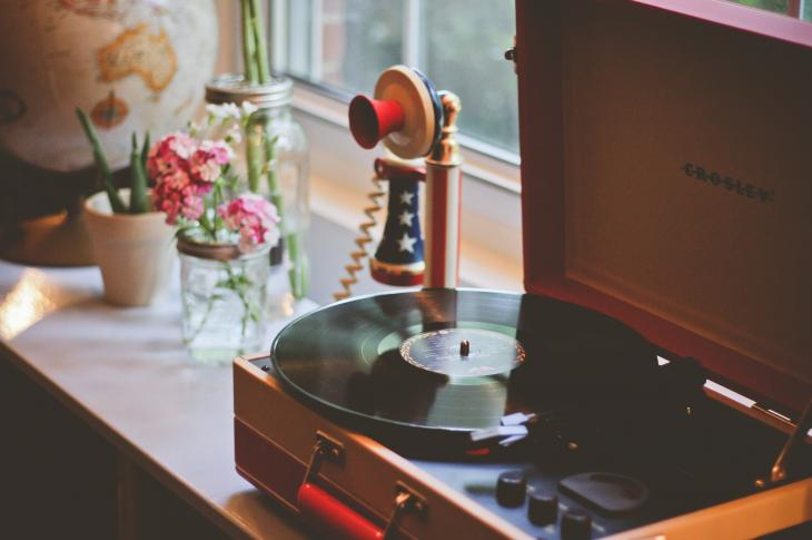 Table with record player and red white and blue phone