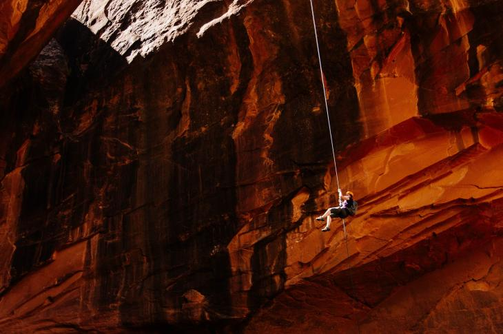 Person rappeling in a cave