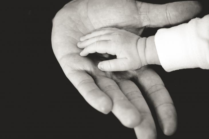 Black and white photo of two hands