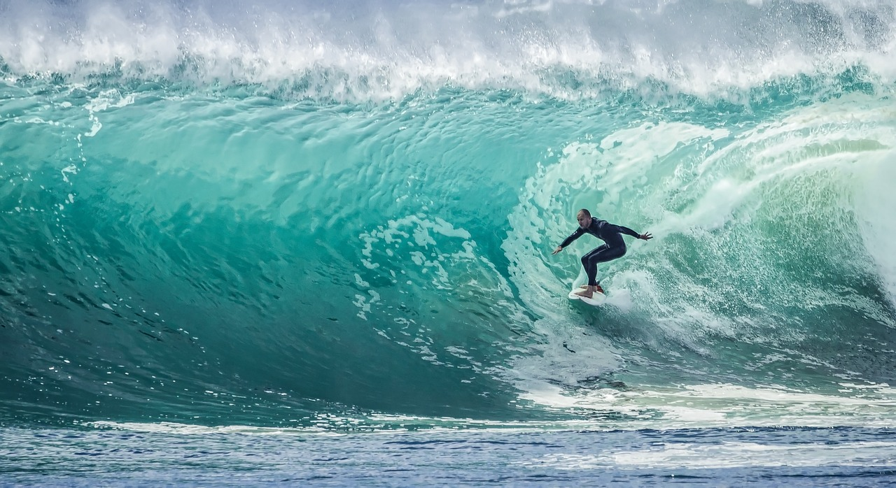 """surfer """"in the zone"""" taking on a big wave"""